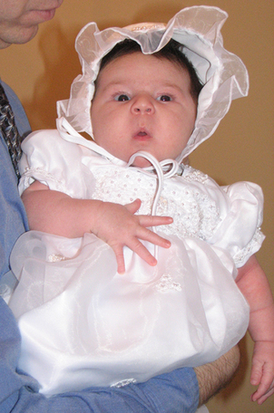 Kara_in_baptism_dress_and_bonnet_2