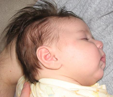 Kara_sleeping_on_daddy